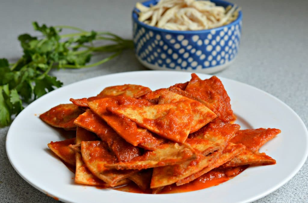Red chilaquiles - smothered in smoky, spicy salsa