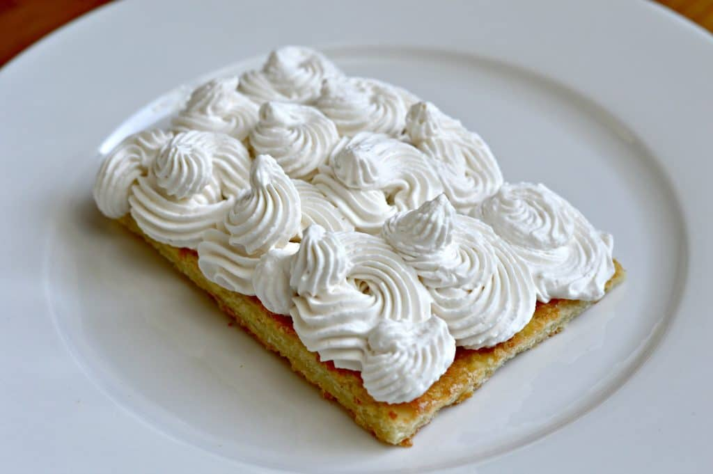 Strawberry and Cream Napoleon - whipping cream on the puff pastry